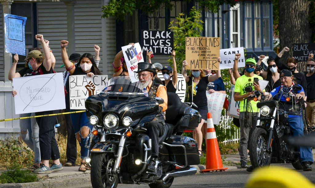 Two bikers rumble by the BLM march down Railroad Avenue during last Friday's rally in Rifle.