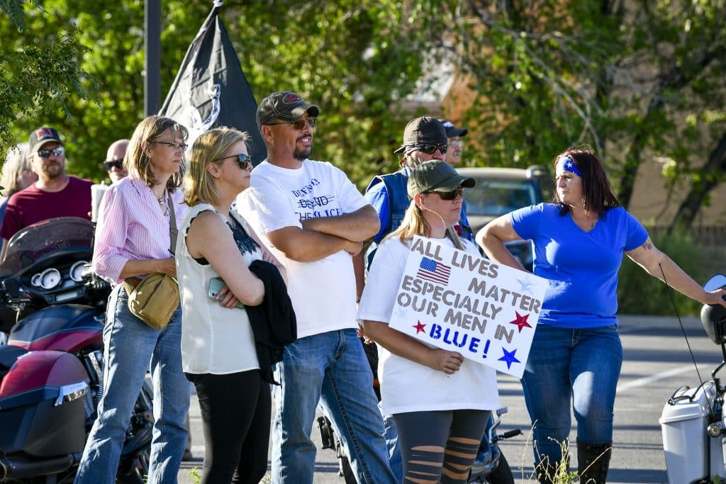 Participants in last Friday's march gather near the fire department last Friday.