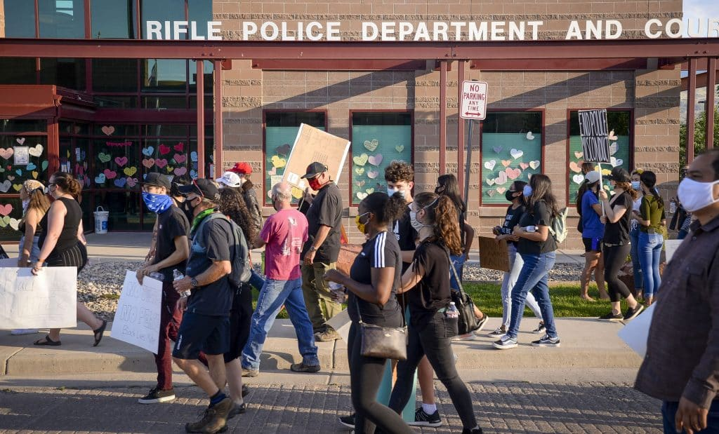 Participants in the Black Lives Matter March walk in front of the Rifle Police Department after making the 16 block trek from city hall last Friday.