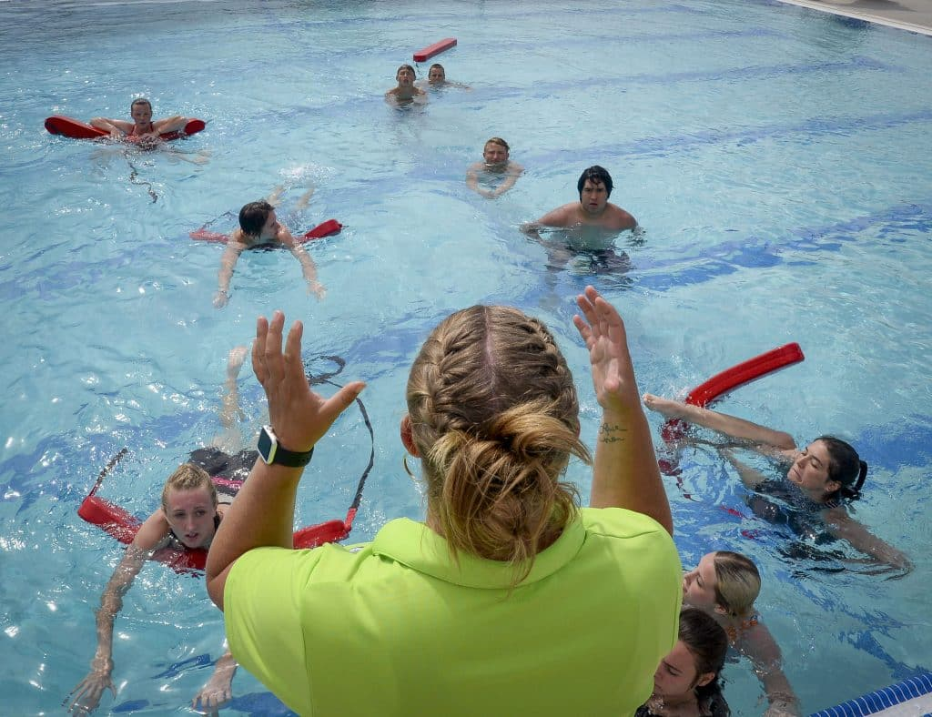Jessica WIlson, aquatics manager at Rifle Metro Pool, works with new lifeguards as they do through water skills tests.