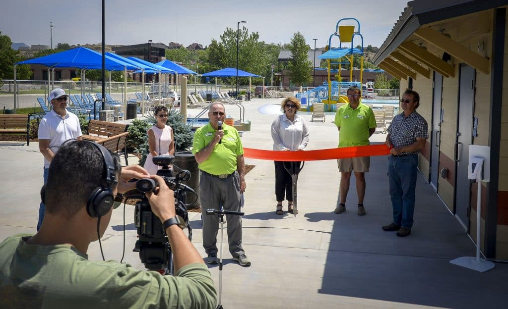 Parks and Recreation Director Tom Whitmore leads a virtual ribbon cutting for the new pool Monday on the opening day of the facility.