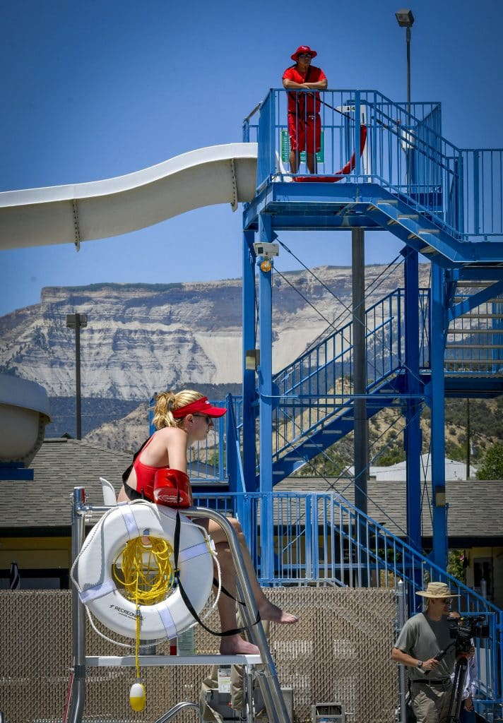 Lifeguards keep watch during the soft opening event Sunday at Rifle Metro Pool.