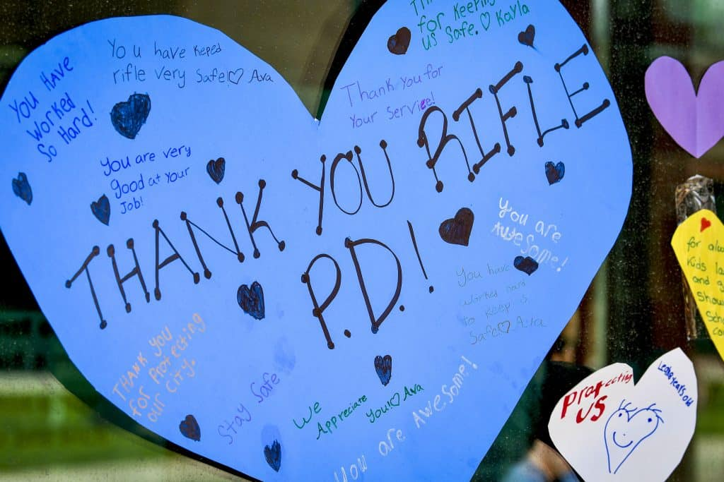 A large heart is displayed on the entry of the Rifle Police Department during an event showing support to the local officers.