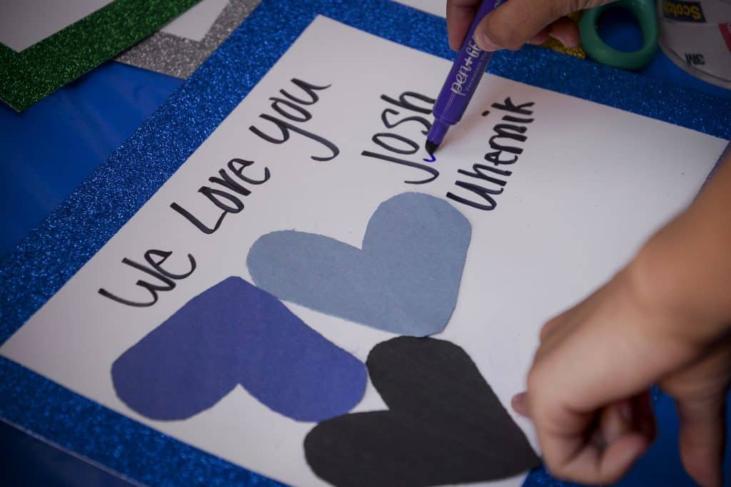 A community member writes a personal message to Rifle Police Officer Josh Uhernik.