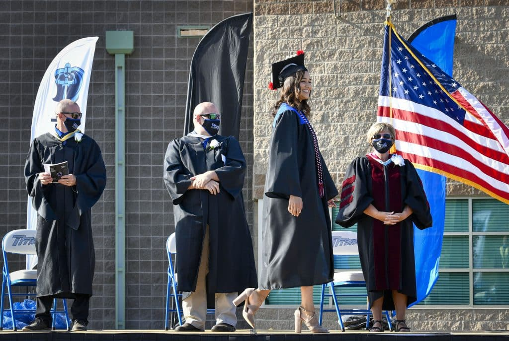 Lyanna Nevarez is all smiles as she walks across the stage during day 1 of in-person commencement ceremonies Saturday at Coal Ridge High School in New Castle.