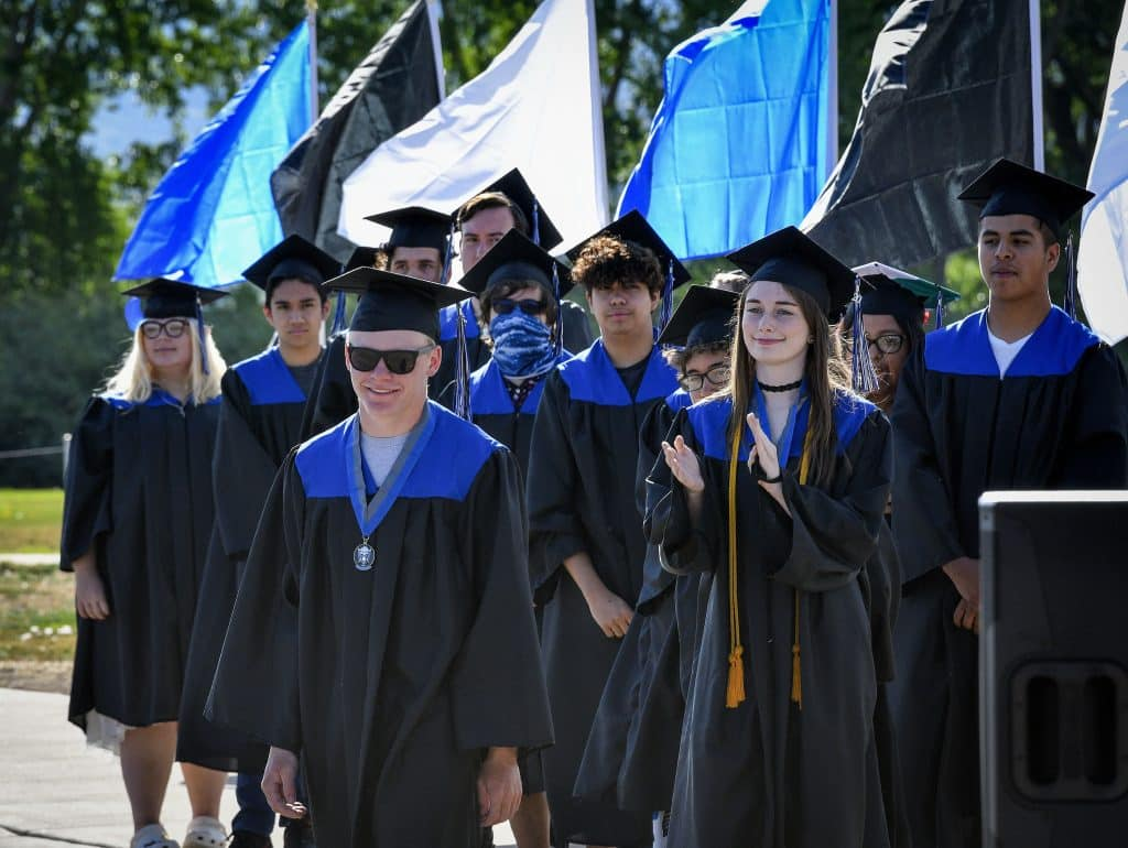 Soon to be Class of 2020 graduates make their way tot he stage as they walk for their in-person graduation Sunday in New Castle.