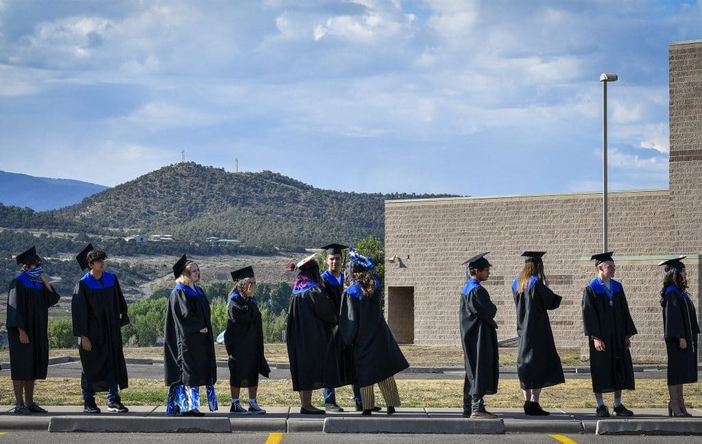 Soon to be Coal Ridge High School graduates patiently wait for the procession to start during day 2 of in-person graduation last Sunday in New Castle.