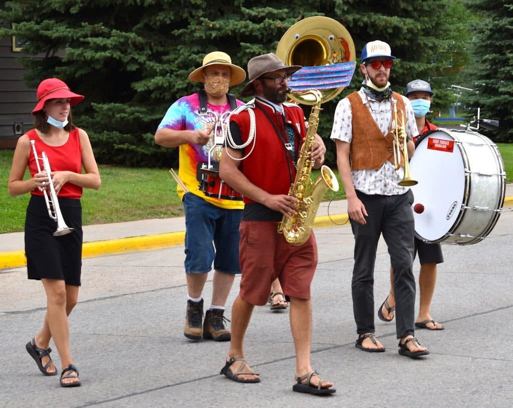 The Fiery Furnace Marching Band from Moab, Utah makes its way across Main Street Saturday afternoon at Mountain Fair in Carbondale.