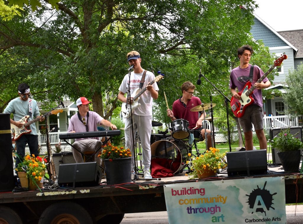 Sleepy Justice plays from the rolling flatbed stage in a River Valley Ranch neighborhood Saturday afternoon.
