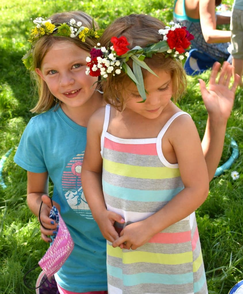 Elouise, left, and Ilse Foss show off their newly made flower wreath crowns Sunday at Mountain Fair in Carbondale.