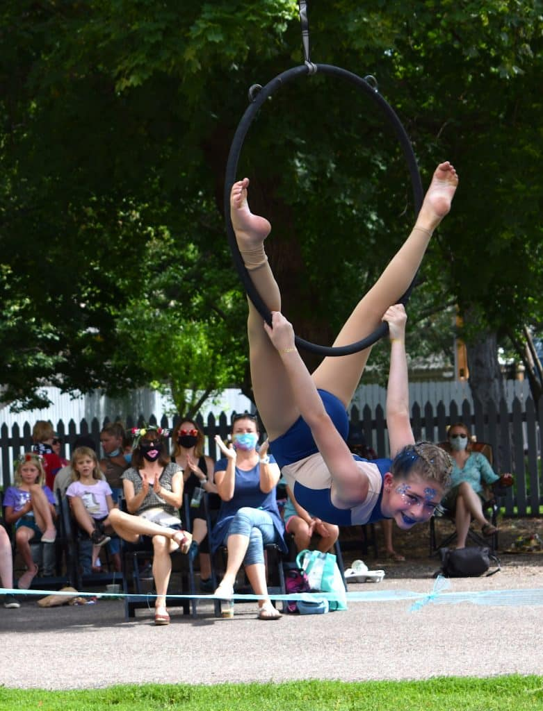 A young contortionist with the Sopris Soarers performs an aerial hoop dance to a small crowd outside the Launch Pad Sunday afternoon.