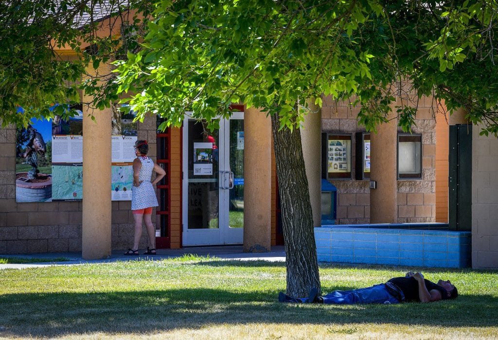 Visitors to the Lion's Park rest area seek shade from the near triple digit heat Saturday in Rifle. The heat wave that has taken hold of western Colorado continues to bring high temperatures to Garfield County.