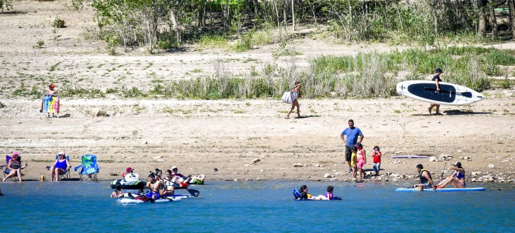 People line the shore of Grass Valley Reservoir at Harvey Gap State Park Saturday near Silt.