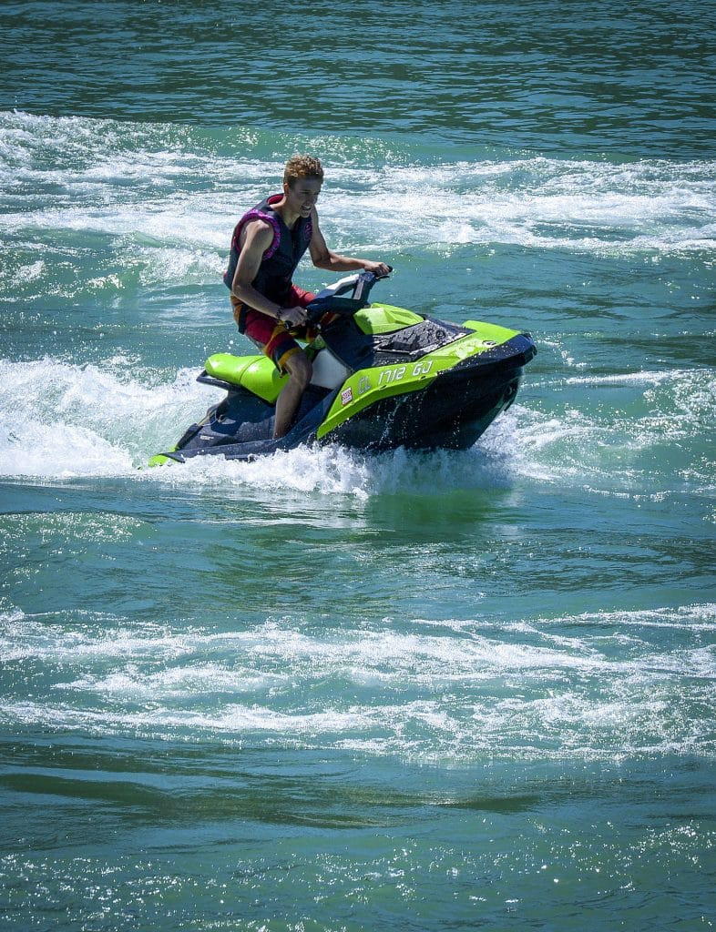 A jet ski rider proves its impossible not to smile while taking a spin on the water at Rifle Gap State Park.