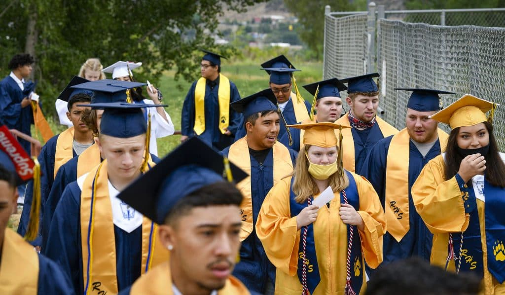 Rifle High School Class of 2020 makes their way into Bear Stadium for the second of three graduation ceremonies honoring graduates Saturday in Rifle.