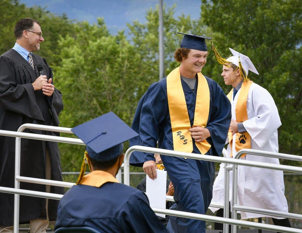 Rifle High School graduate Levi Warfel is all smiles after receiving his diploma Saturday during the final of three ceremonies held at Bear Stadium.