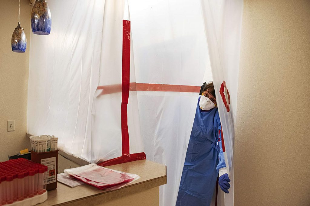 Nurse Practitioner Lisa Robbiano looks out of the COVID-19 screening area in the MidValley Family Practice office in Basalt on Thursday, July 2, 2020. (Kelsey Brunner/The Aspen Times)