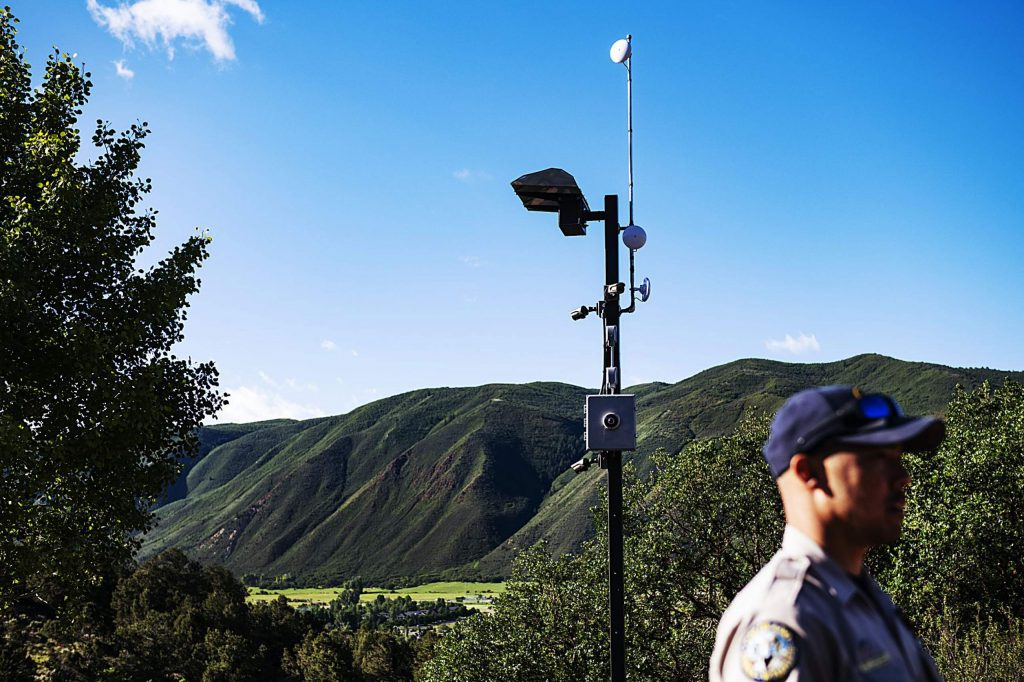 Colorado Parks and Wildlife area wildlife manager Matt Yamashita stands in the parking lot of the Basalt Public Shooting Range in front of a new security camera and antenna set up in El Jebel on Tuesday, June 30, 2020. (Kelsey Brunner/The Aspen Times)