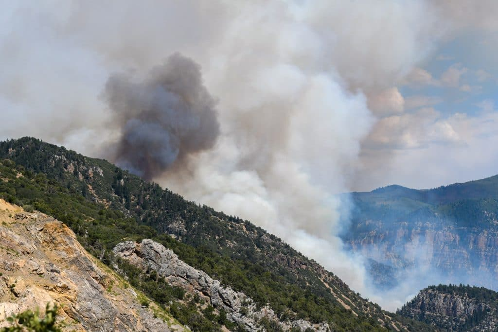 Smoke billows from the canyon walls as the Grizzly Creek Fire explodes in Glenwood Canyon on Monday afternoon.
