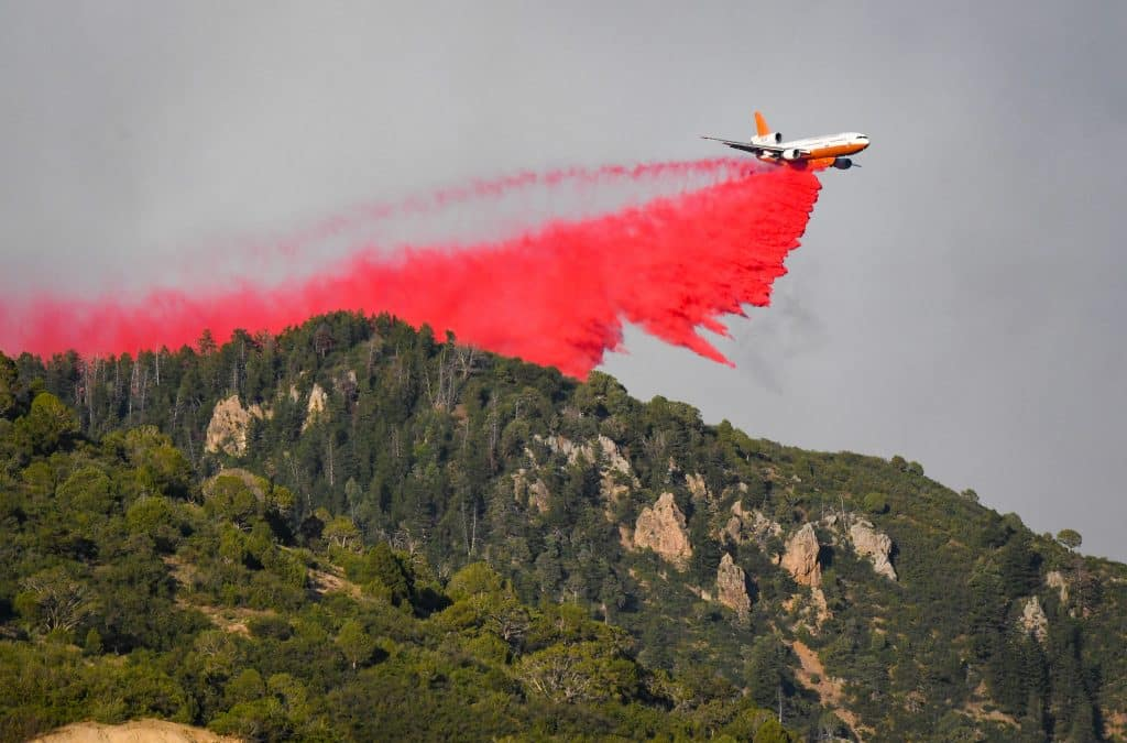 An airtanker drops fire retardant slurry on the ridge directly above No Name after the Grizzly Creek Fire broke out inside Glenwood Canyon just east of Glenwood Springs on Monday afternoon.