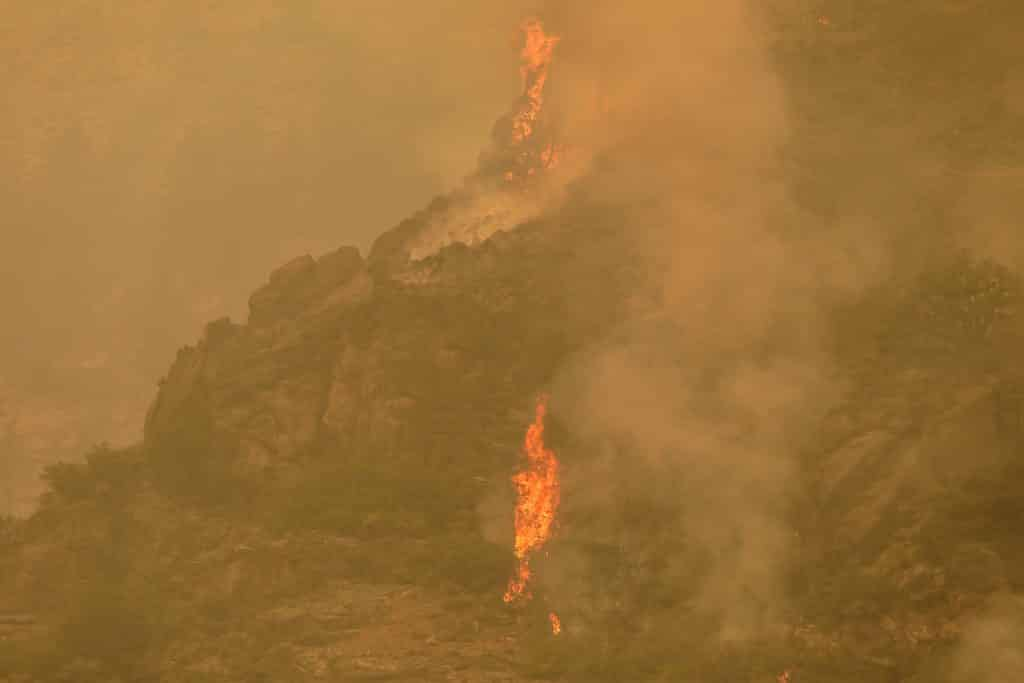 Flare-ups take place on the Grizzly Creek Fire Sunday in Glenwood Canyon.