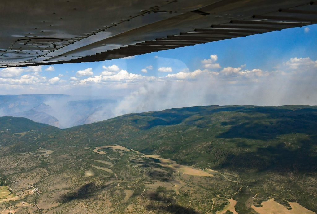 The Grizzly Creek Fire continues to burn inside Glenwood Canyon as seen from the air above Missouri Heights on Wednesday morning.