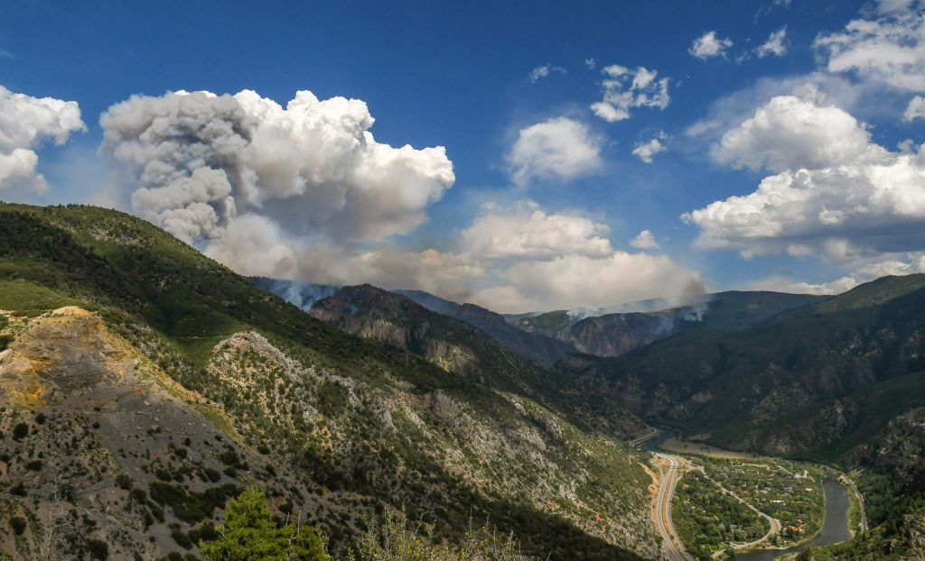 Smoke billows from the Grizzly Creek Fire above No Name Canyon and on the south side of the Colorado River above Glenwood Canyon on Wednesday afternoon.
