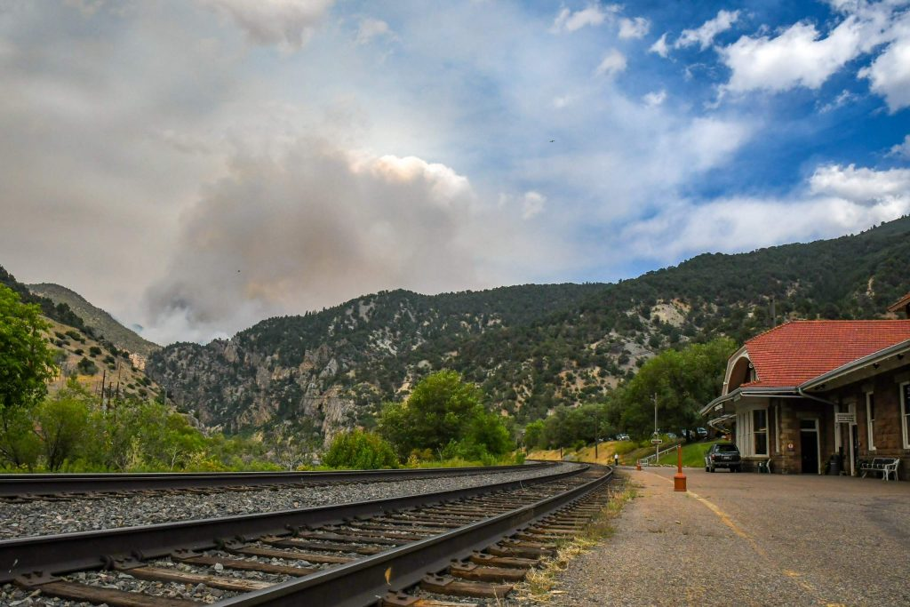 Smoke from the Grizzly Creek Fire billows in Glenwood Canyon after the fire jumped the Colorado River on the south side of Glenwood Canyon, halting Amtrak traffic through the canyon.