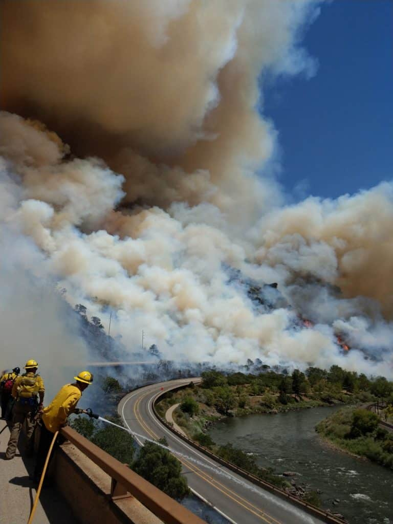 The Grizzly Creek wildfire in Glenwood Canyon east of Glenwood Springs blows up fast Monday afternoon, Aug. 10, as firefighters observe from the upper (westbound) deck of Interstate 70.