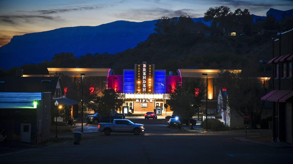 Dusk settles in on downtown Rifle as the lights of movie theater light up the early evening hours.