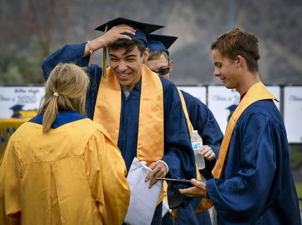 Noah Cartmell is all smiles as he celebrates with member of the Class of 2020 after graduating Saturday at Bear Stadium in Rifle.