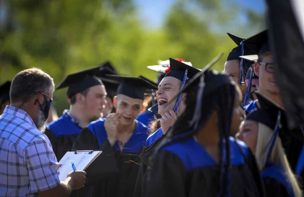 Members of the Coal Ridge High School Class of 2020 line up for the procession across the stage during day 2 of in-person commencement Sunday in New Castle.