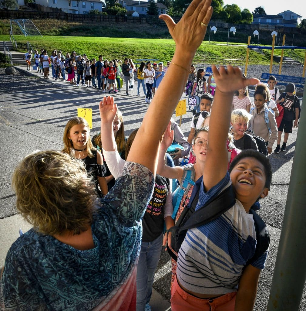 School is back in session in Rifle as students celebrate the first day with a high-five as they file into Higland Elementary School Monday morning. For more photos from the first day of school at Hihgland see page 4.