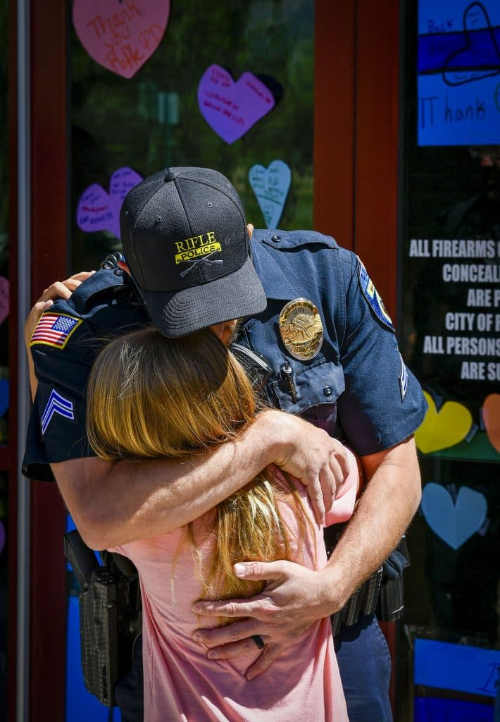 Rifle Police Cpl. Jared Bartunek recieves a big hug from his daughter when he arrived at the police department durin glast weeks event.