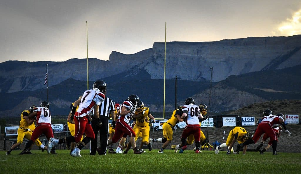 With the Roan Plateau looming in the background action heats up on the gridiron as Rifle hosts Grand Valley at Bear Field.