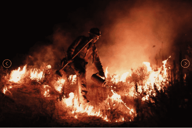A firefighter works to hold the line on Aug. 15. The Grizzly Creek Fire is now at 4% containment.