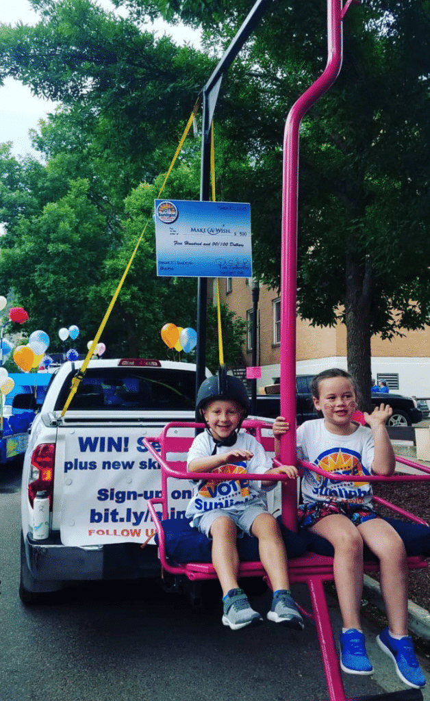 Former Sunlight Mountain Resort Mini-Mayor Colby Rogers with her little brother, Kelby, as they participated in a parade to help drum up awareness of the Mini-Mayor contest.