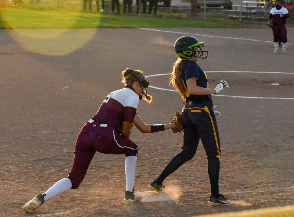 Rifle Bear Myia Valencia is tagged by a Palisade Bulldog after taking a lead off third base during Tuesday night's home game.