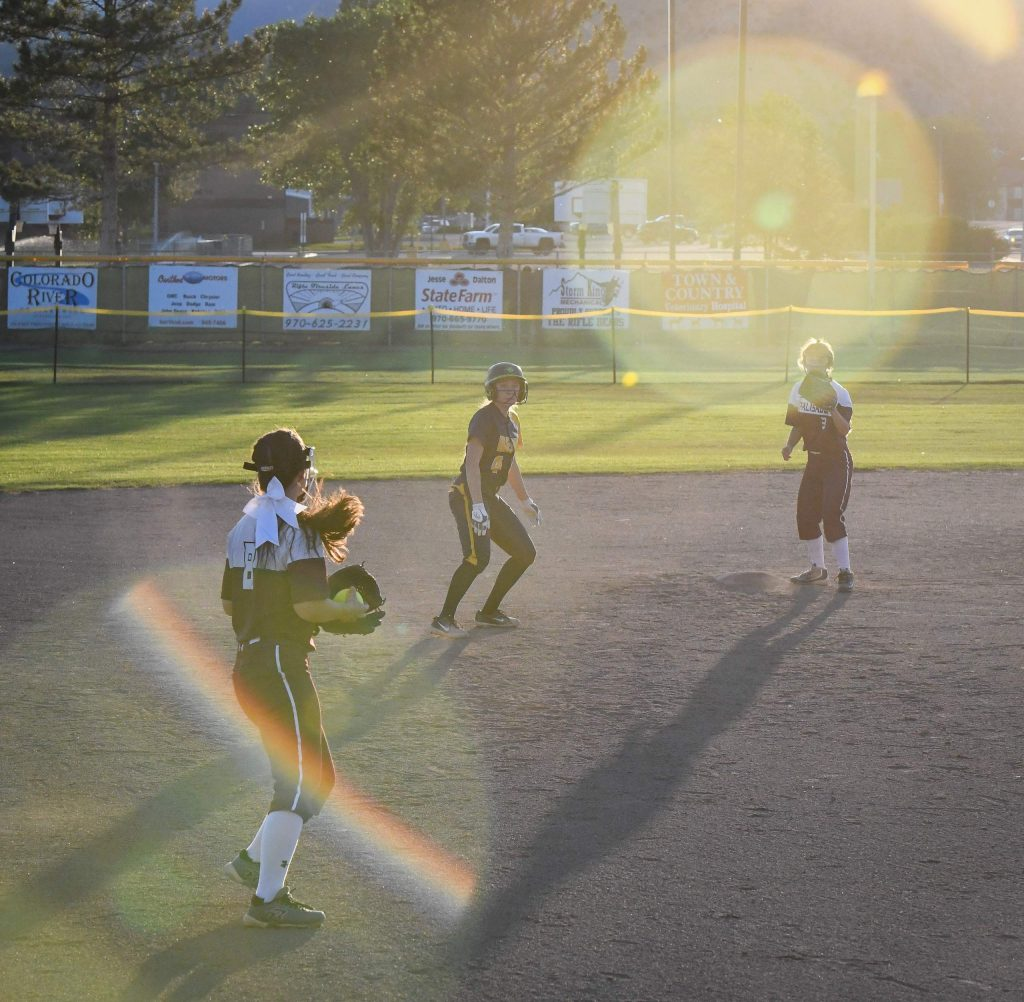 Rifle Bear Myia Valencia gets looked back to second base by the Palisade Bulldogs during Tuesday night's home game.