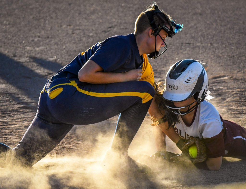 Rifle Bear third baseman Emma Poole attempts to get an out at the base during Tuesday night's game against the Palisade Bulldogs.