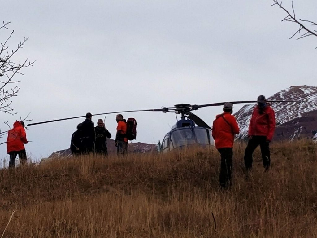 Resucers, along with a flight for life helicopter, stage near Maroon Lake on Friday afternoon as crews search for a climber who fell on a trail near the Maroon Bells.