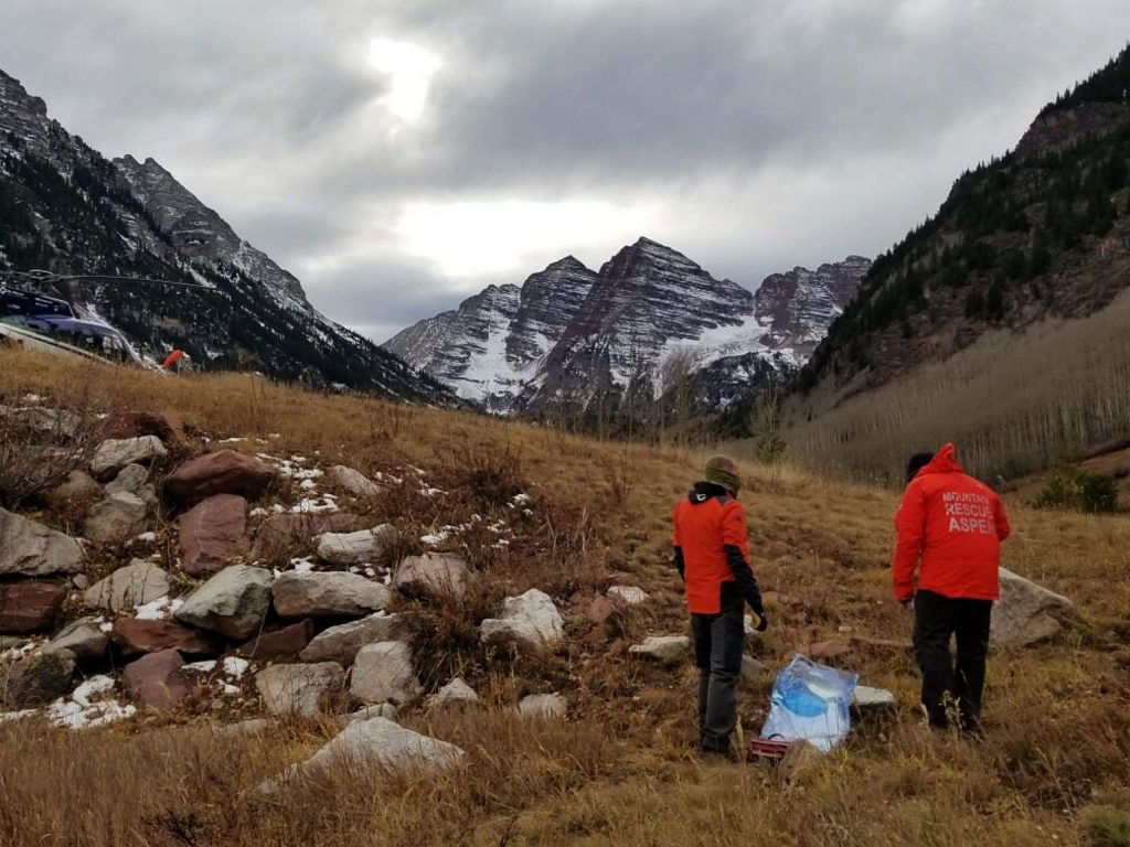 Rescuers, along with a CareFlight of the Rockies helicopter, stage near Maroon Lake on Friday afternoon as crews search for a climber who died on on the Maroon Bells.